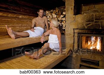 stock photo of germany senior woman and man sitting in sauna babf00363 search stock images. Black Bedroom Furniture Sets. Home Design Ideas