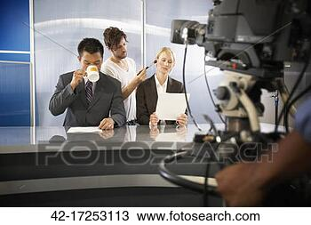 Stock Photo - newscasters in  television studio  getting prepared.  fotosearch - search  stock photos,  pictures, images,  and photo clipart