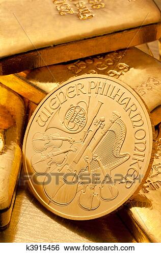 Stock Photo - investment in  real gold than  gold bullion and  gold coins. fotosearch  - search stock  photos, pictures,  wall murals, images,  and photo clipart