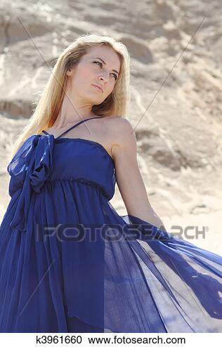 Stock Photography - girl in dark blue  dress on the sand.  fotosearch - search  stock photos,  pictures, wall  murals, images,  and photo clipart