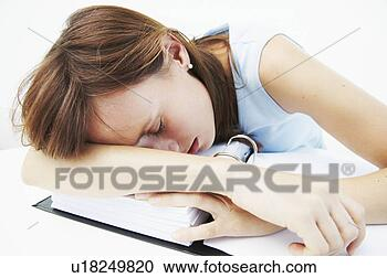 Stock Photography - businesswoman  asleep over file.  fotosearch - search  stock photos,  pictures, wall  murals, images,  and photo clipart