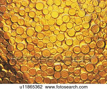 Stock Photo - coins covered  with gold liquid.  fotosearch - search  stock photos,  pictures, wall  murals, images,  and photo clipart