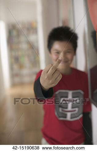 Stock Photo - boy flipping the  bird. fotosearch  - search stock  photos, pictures,  wall murals, images,  and photo clipart
