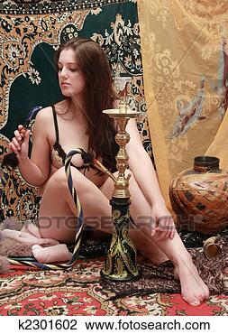 Stock Photo - sexy girl with  hookah. fotosearch  - search stock  photos, pictures,  images, and photo  clipart