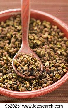Stock Image - szechuan pepper in bowl with spoon. fotosearch - search stock photos, pictures, images, and photo clipart