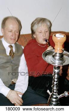 Stock Photograph - senior couple  smoking water  pipe. fotosearch  - search stock  photos, pictures,  images, and photo  clipart