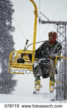 Stock Photograph - man w/ hookah  on ski lift, gulmarg,  kashmir, india.  fotosearch - search  stock photos,  pictures, images,  and photo clipart