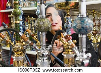 Stock Photo - woman with hookahs.  fotosearch - search  stock photos,  pictures, images,  and photo clipart