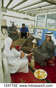 Stock Photo - men on a boat  smoking a hookah,  kuwait. fotosearch  - search stock  photos, pictures,  images, and photo  clipart