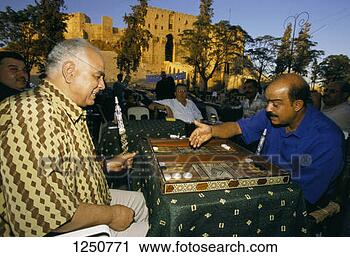 Stock Photography - men playing backgammon  outdoors, aleppo,  syria. fotosearch  - search stock  photos, pictures,  images, and photo  clipart