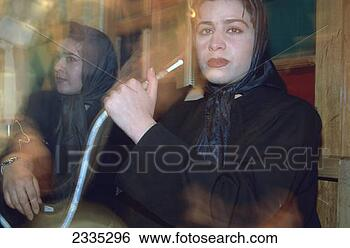 Stock Photo - woman smoking  a hookah, tehran,  iran. fotosearch  - search stock  photos, pictures,  images, and photo  clipart