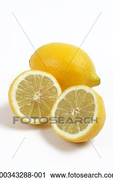 Stock Photography - lemon halves by  whole lemon. fotosearch  - search stock  photos, pictures,  images, and photo  clipart
