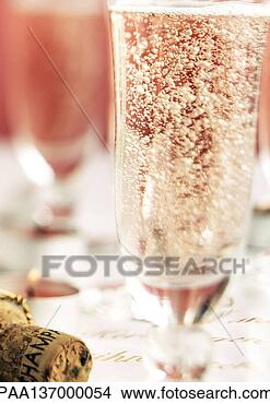 Stock Photo - glass of champagne,  close-up. fotosearch  - search stock  photos, pictures,  wall murals, images,  and photo clipart