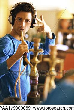 Stock Photograph - man wearing headphones,  holding hookah  like a microphone.  fotosearch - search  stock photos,  pictures, images,  and photo clipart