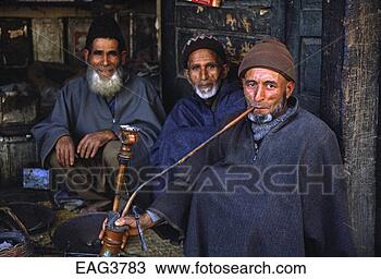 Stock Photo - muslim kashmiri  men smoke a hukkah  (hookah) in front  of a small store.  fotosearch - search  stock photos,  pictures, images,  and photo clipart