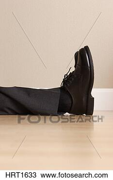 Stock Photo - legs and feet  of laying businss  man. fotosearch  - search stock  photos, pictures,  images, and photo  clipart