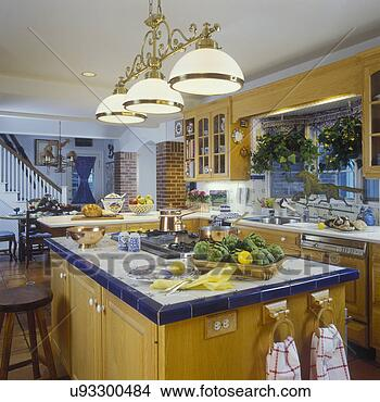 Stock Photo of KITCHEN - French country. Island. Blue ceramic tile
