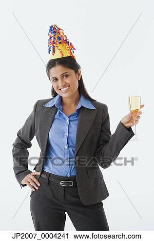 Stock Photography - indian businesswoman  wearing party  hat. fotosearch  - search stock  photos, pictures,  wall murals, images,  and photo clipart